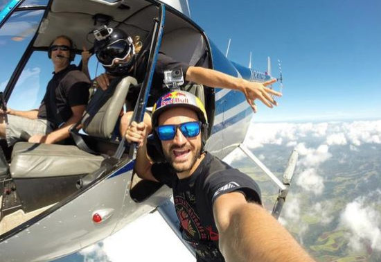 Man Hanging Outside of Helicopter Selfies
