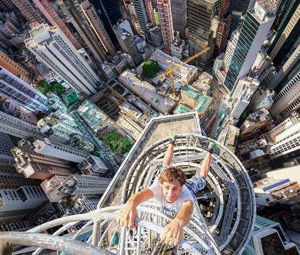 Man Hangs of Side of Building Selfies
