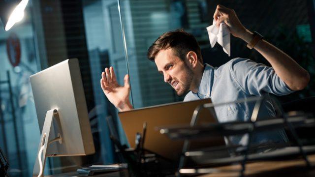 angry dude at his computer