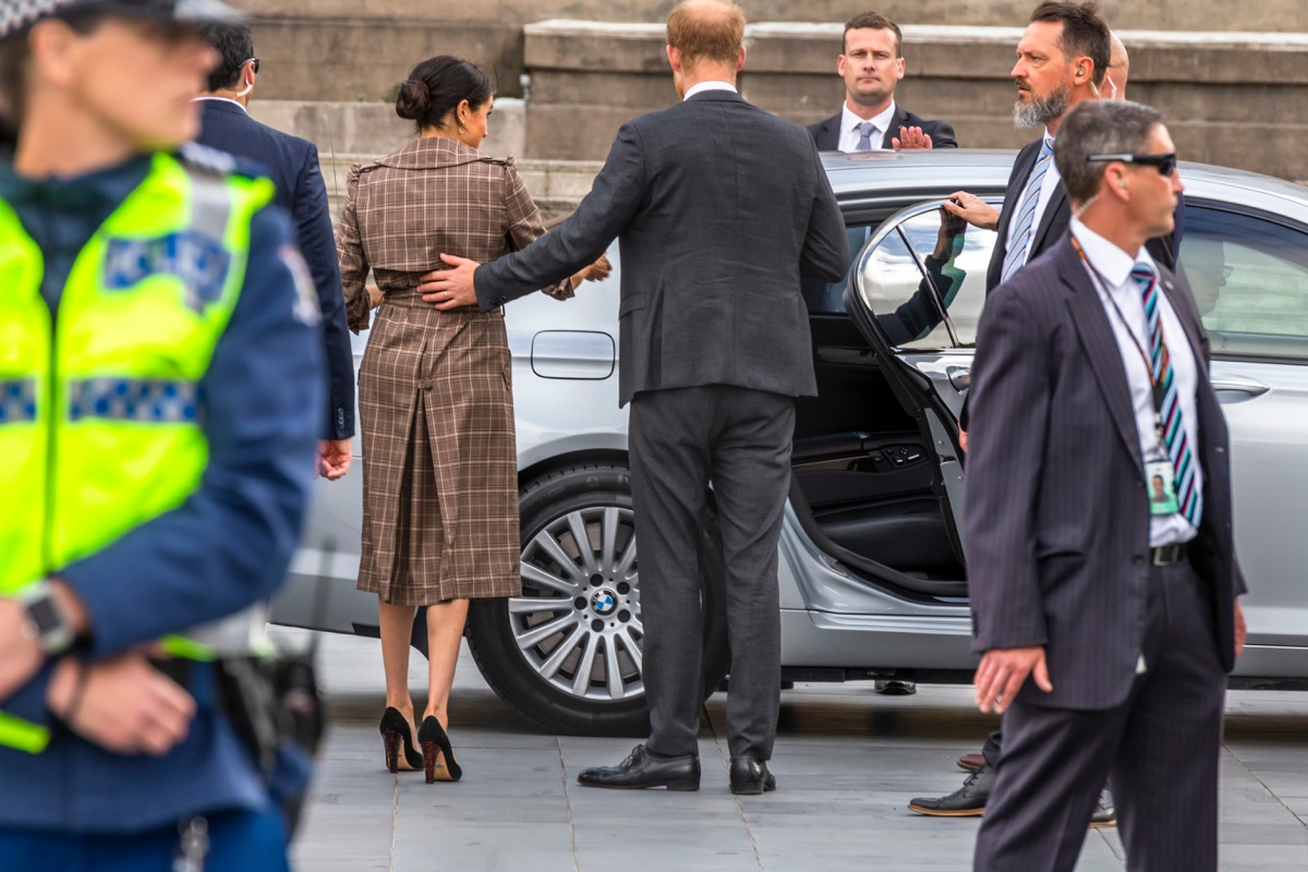 prince harry helping meghan into a car, prince harry father