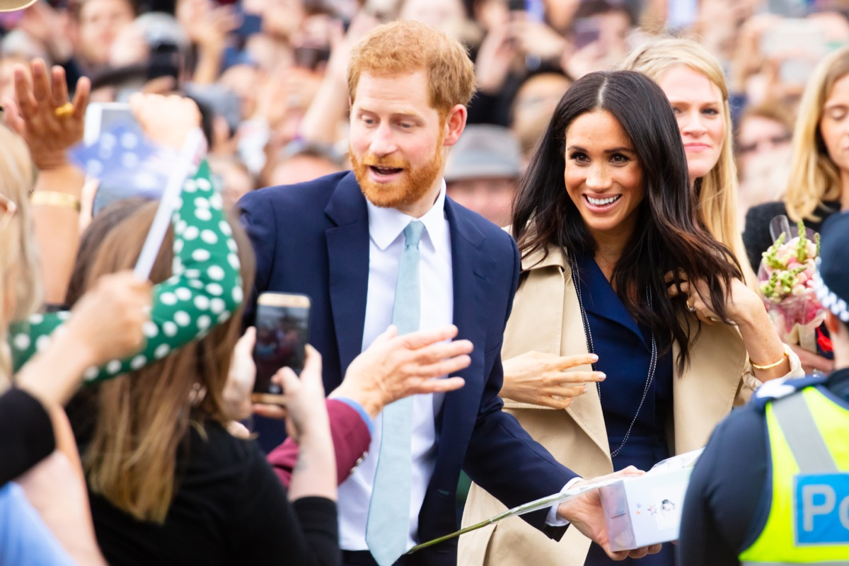 meghan and harry in a crowd, prince harry dad