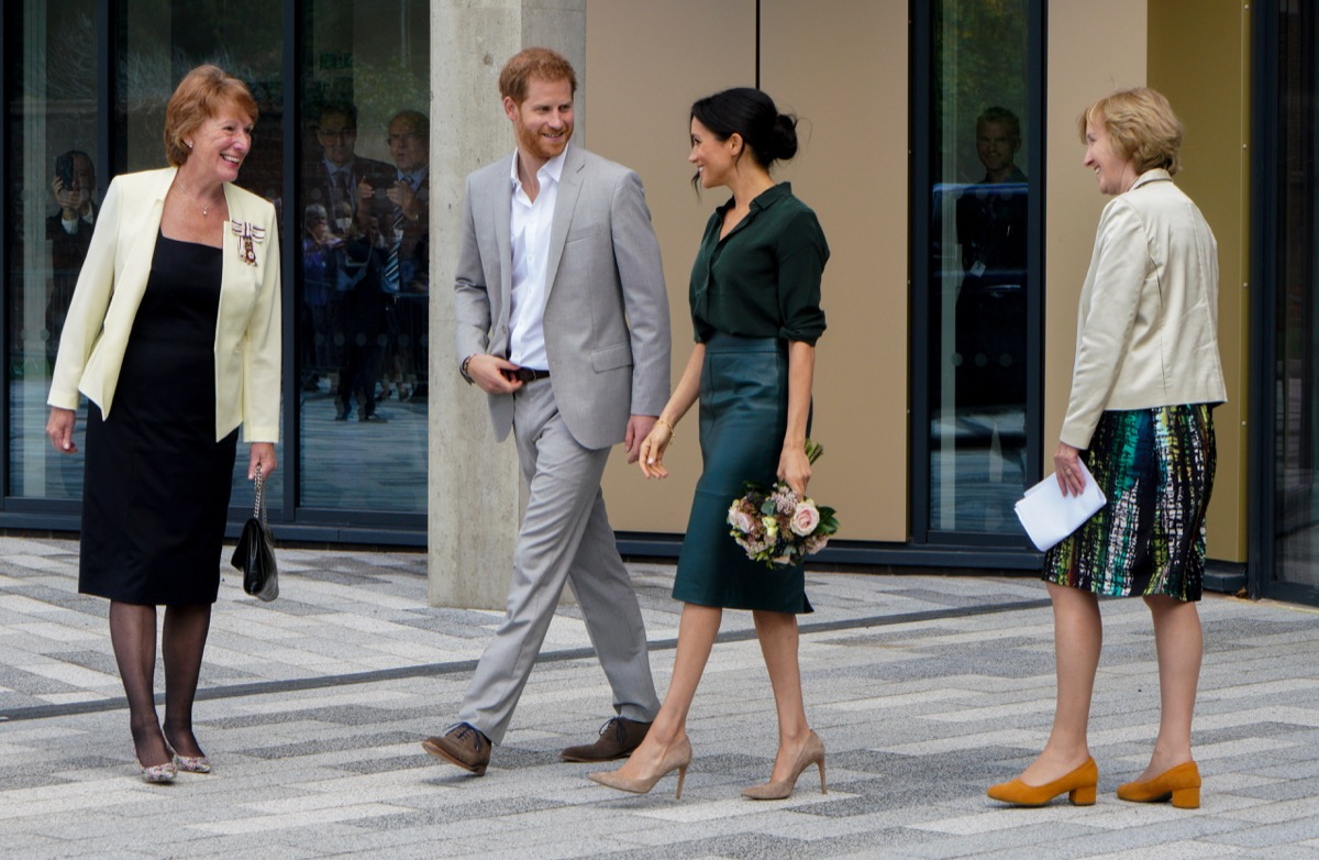 meghan and prince harry walking together, prince harry father