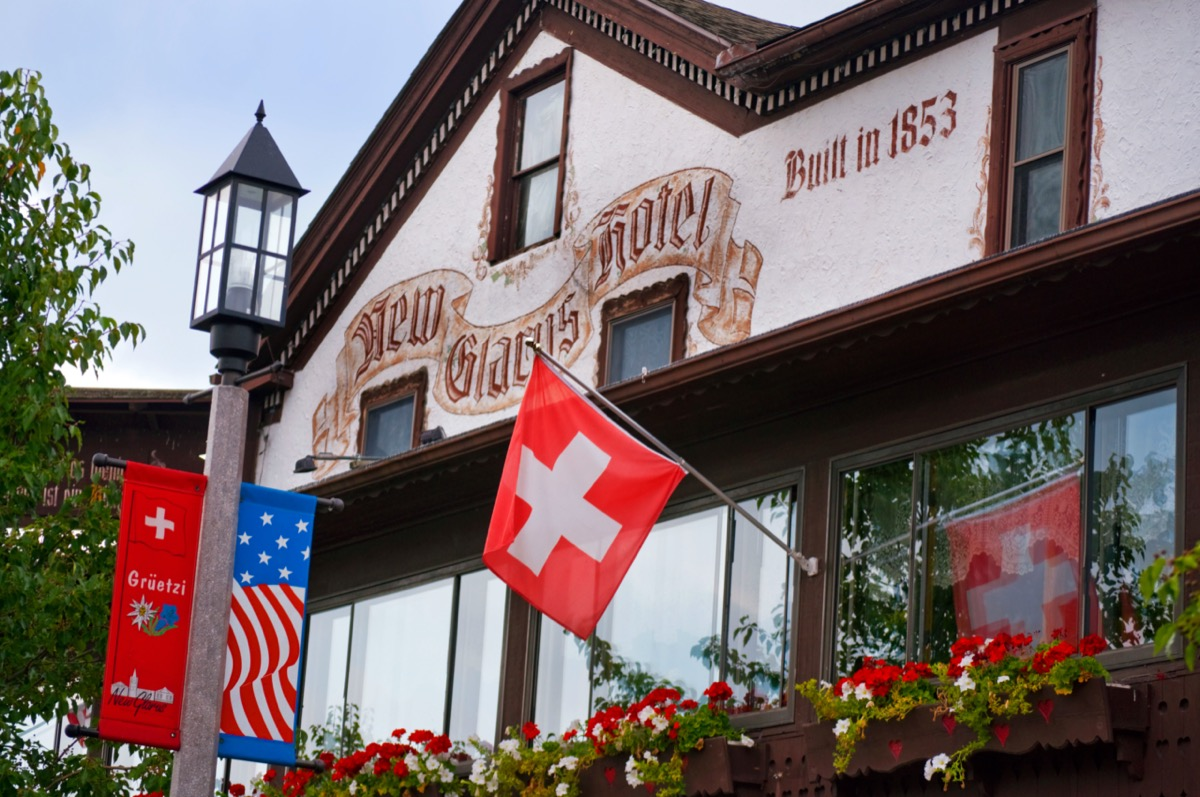 swiss-style house with a swiss flag