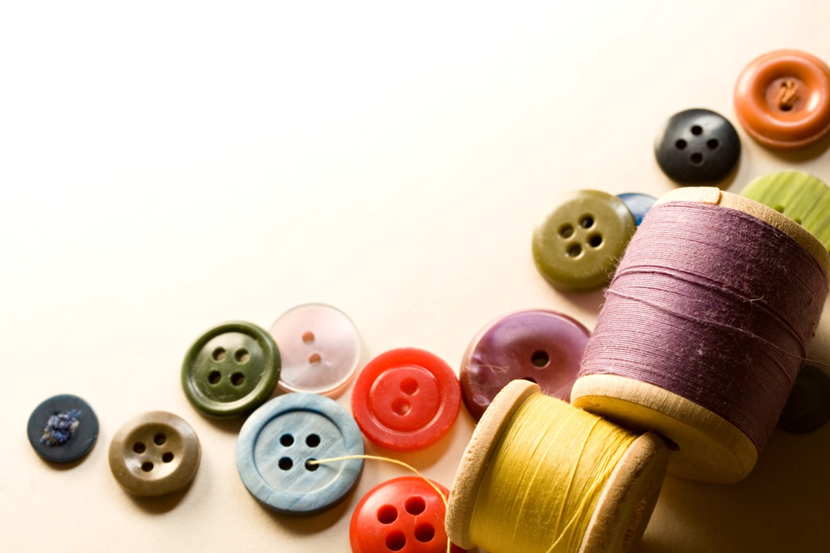 pile of buttons and sewing materials, astonishing facts