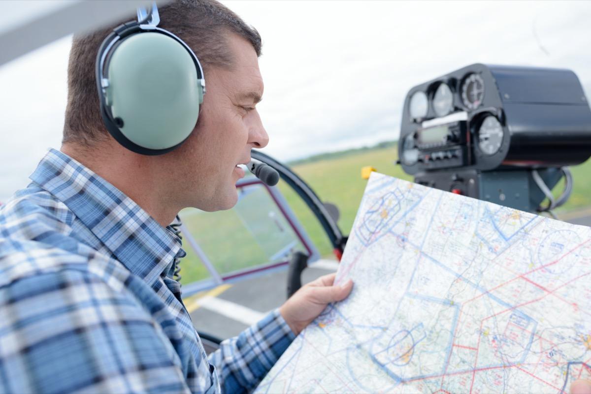 pilot studying a map