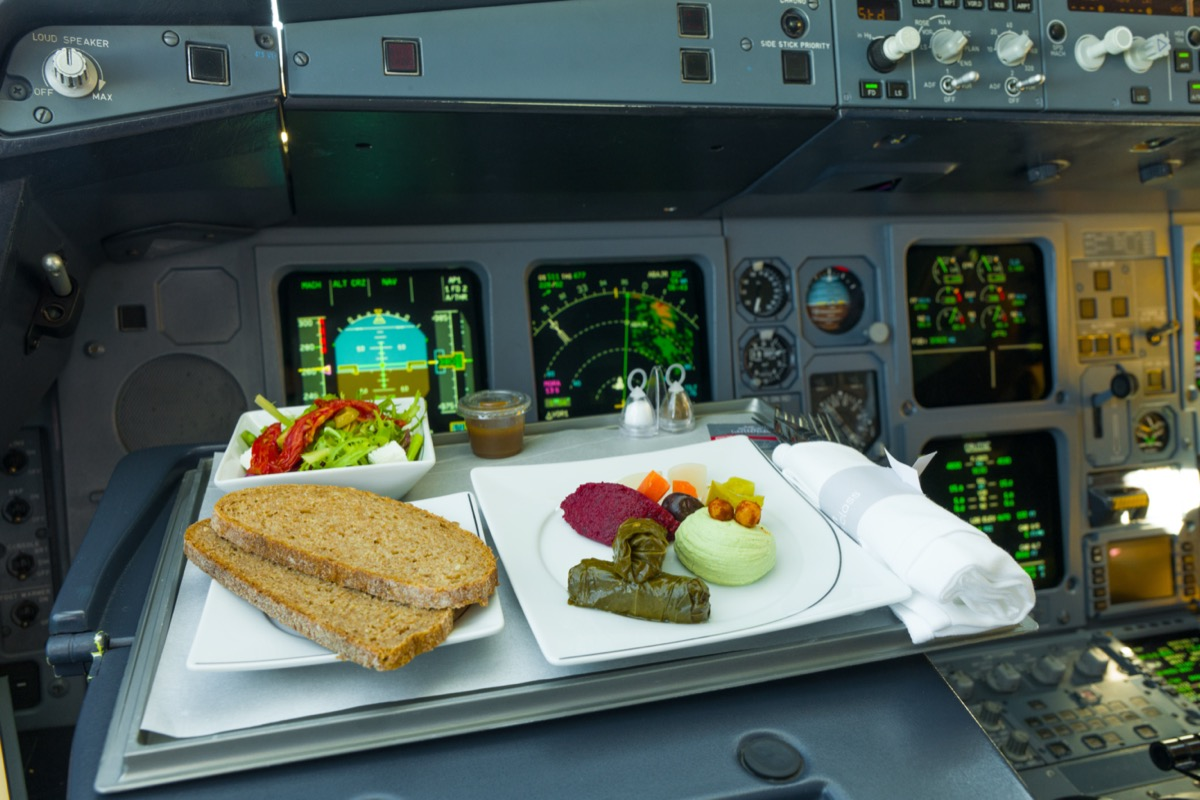 a pilot's food tray in the cockpit