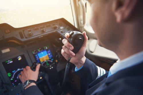 pilot talking on his radio