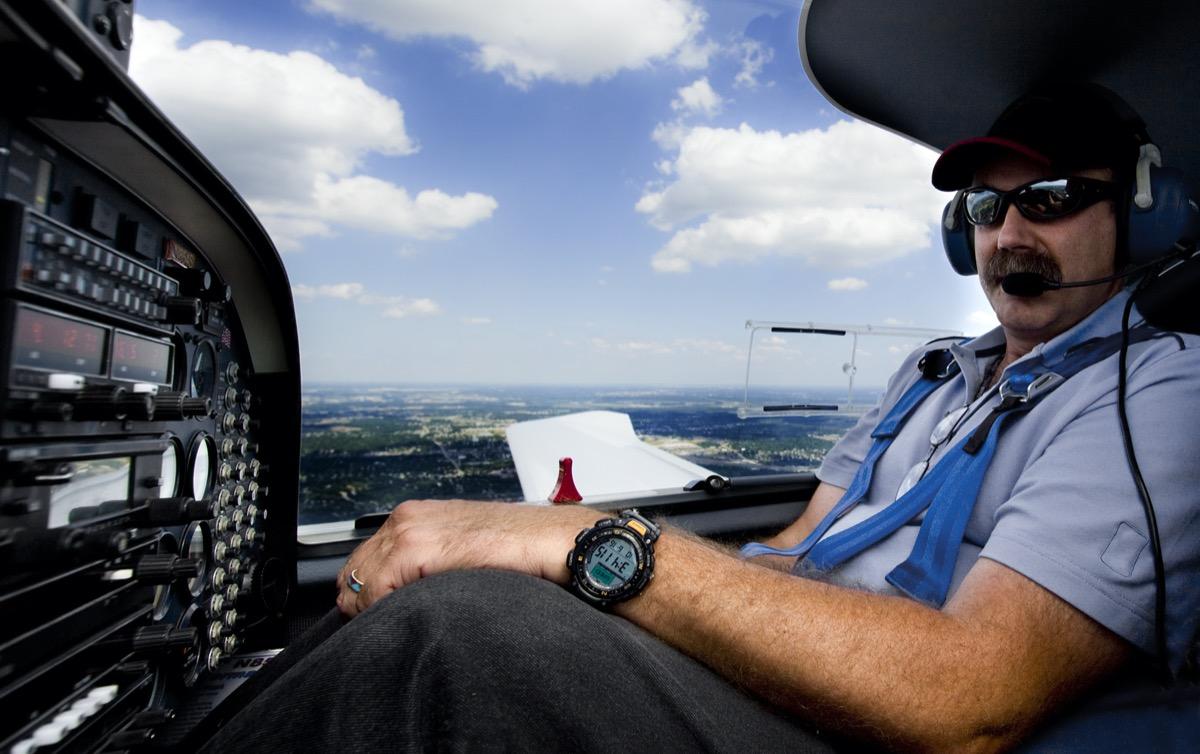 pilot listening through his headphones