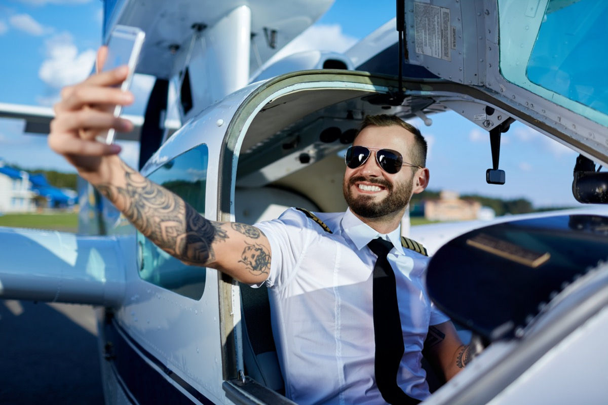 young pilot taking a selfie