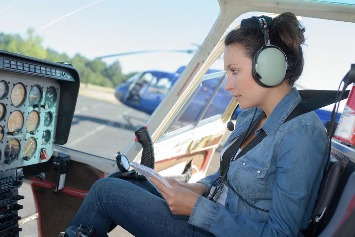 female pilot studying