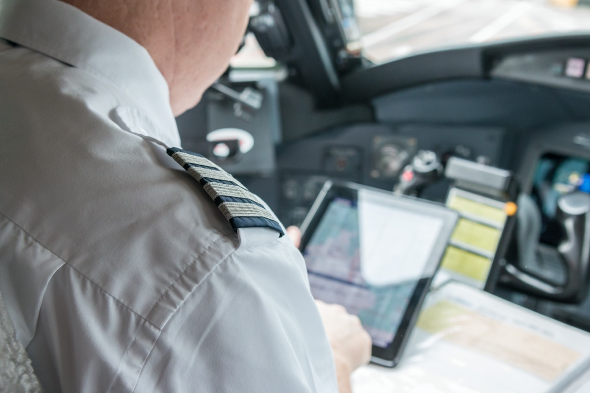 pilot checking his tablet