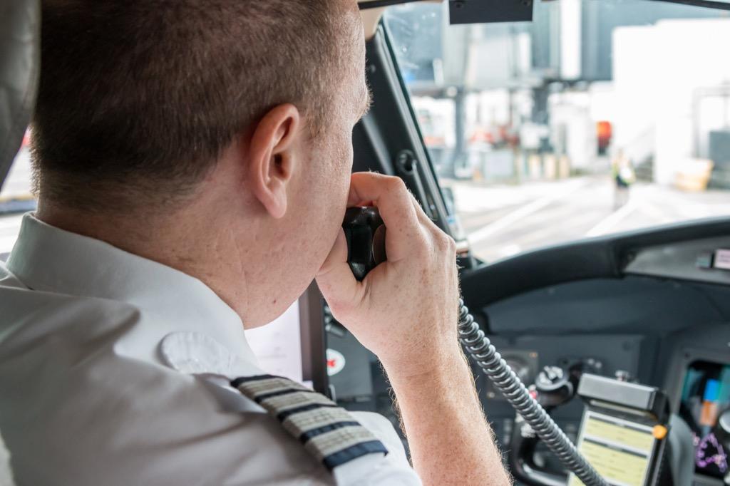 pilot talking on intercom
