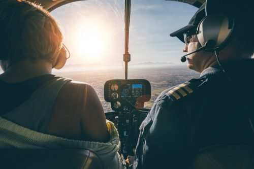 two pilots in the cockpit during sunset
