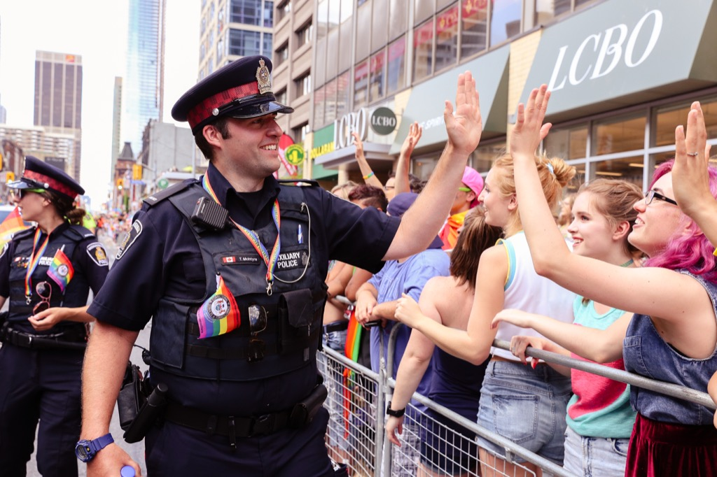 police officer highfives crowd at parade