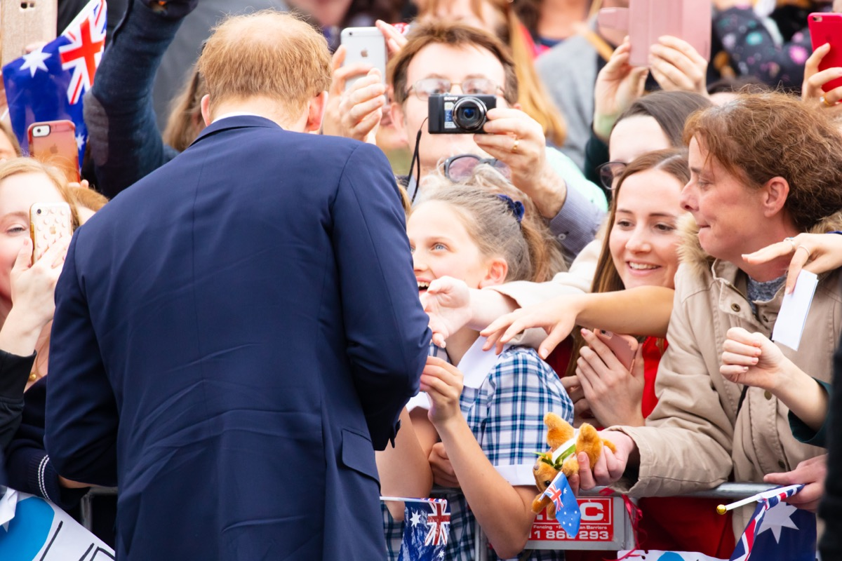 prince harry speaking to a crowd of kids, prince harry father
