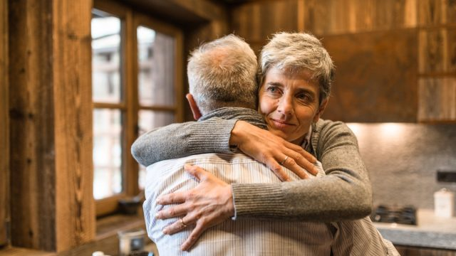 senior couple embracing at home