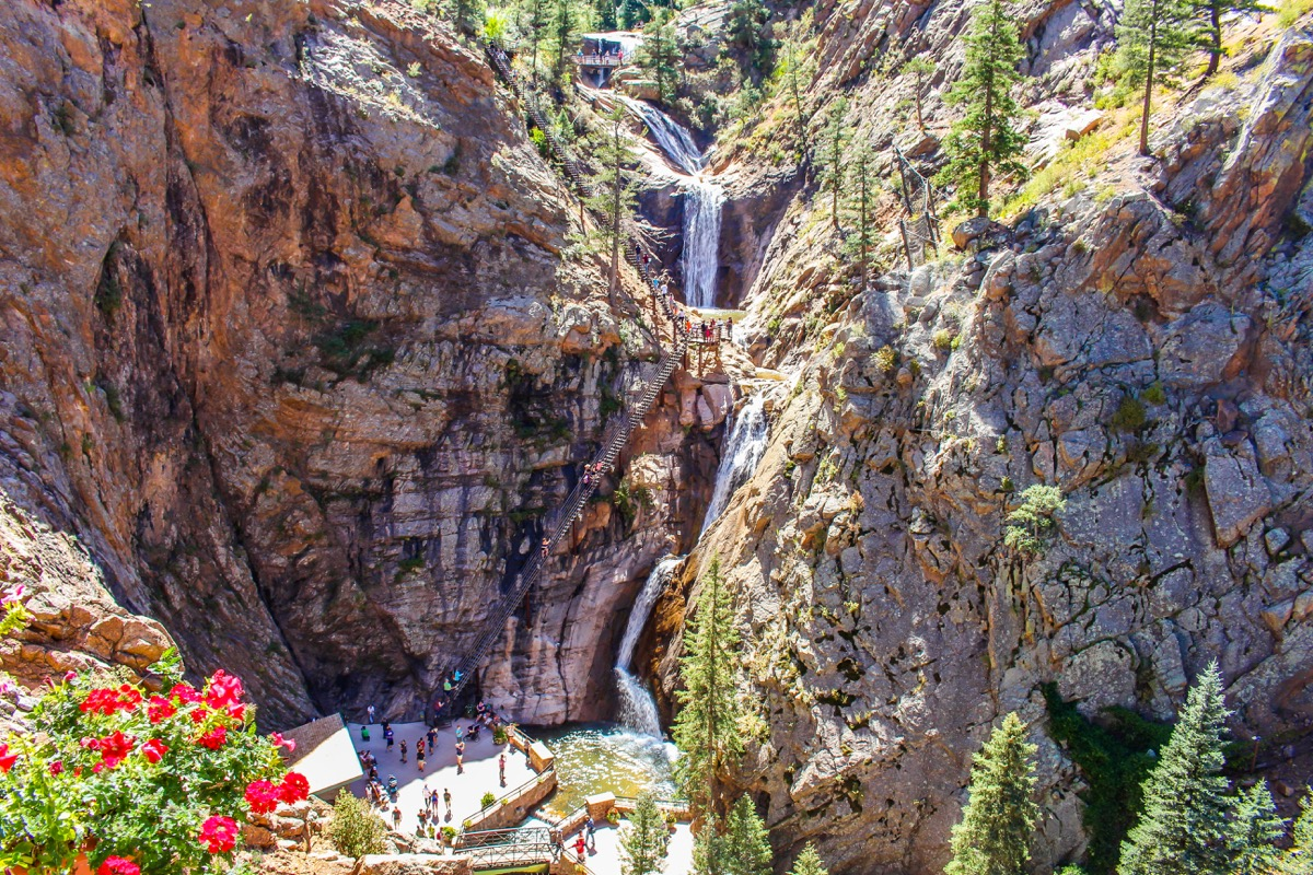 seven falls with tourists down below in Colorado