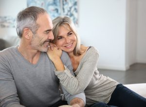 happy couples in their 50s sitting on couch, better wife after 40