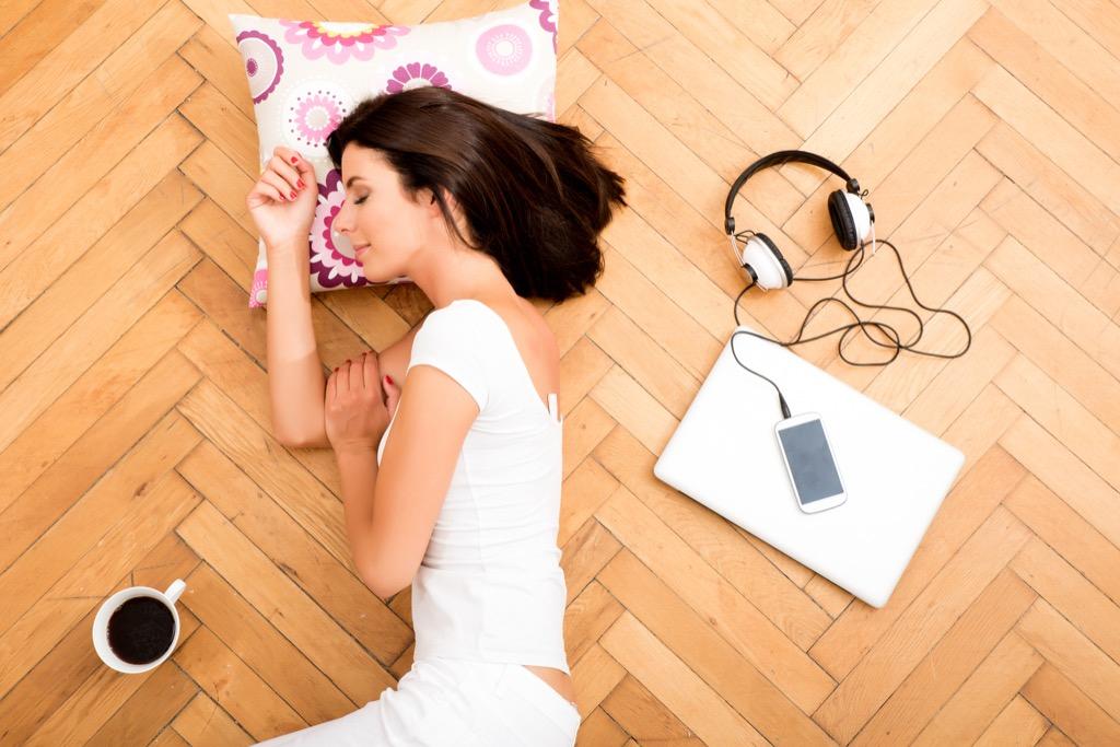 Woman sleeping on the floor