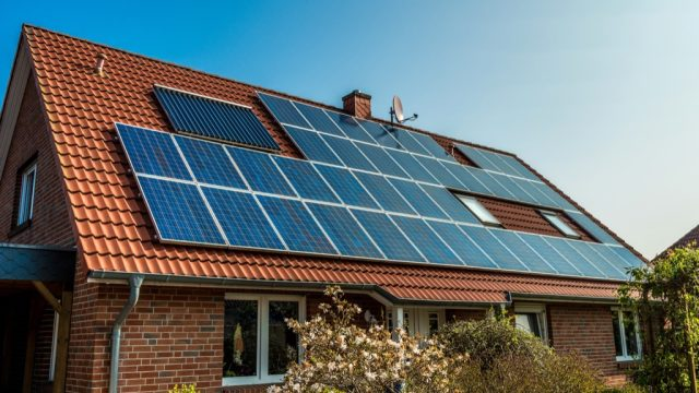 eco friendly house with solar panels roof