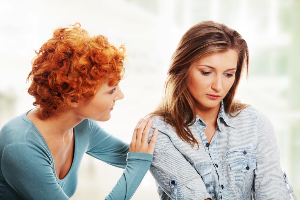 woman comforts upset friend