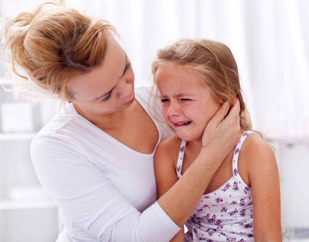 mom comforting crying child