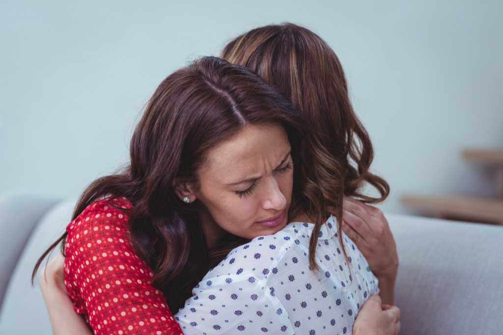 Women Hugging Pay it Forward Stories