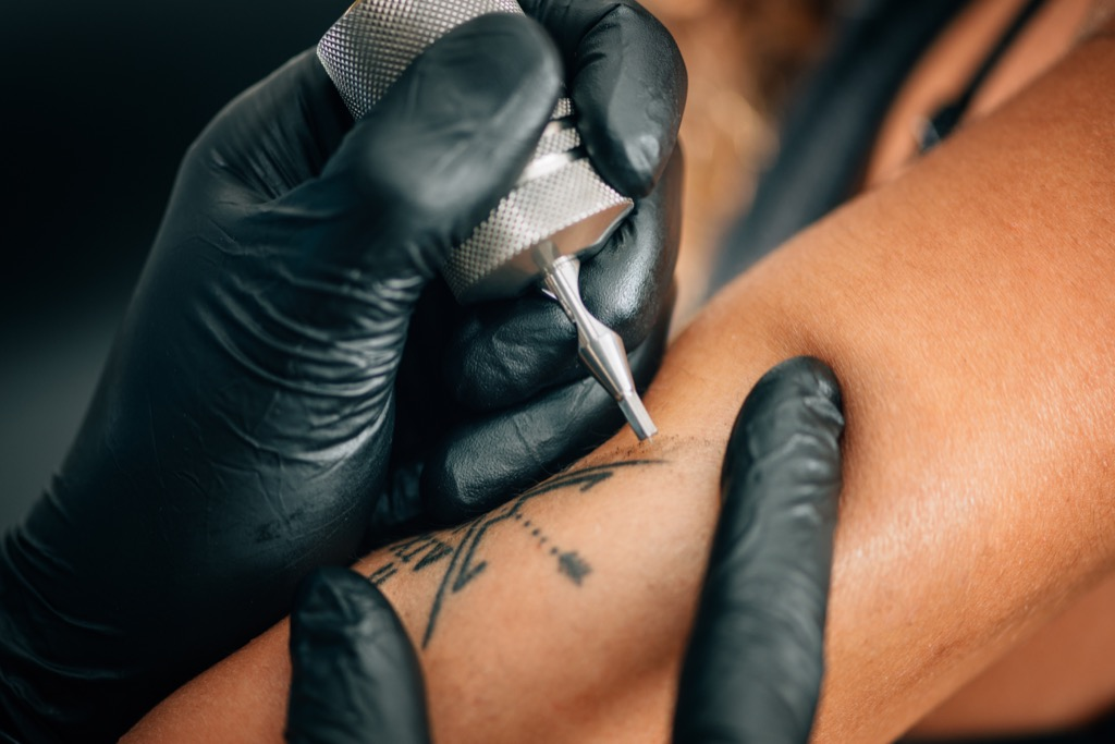 a woman getting first-time tattoos, bad parenting