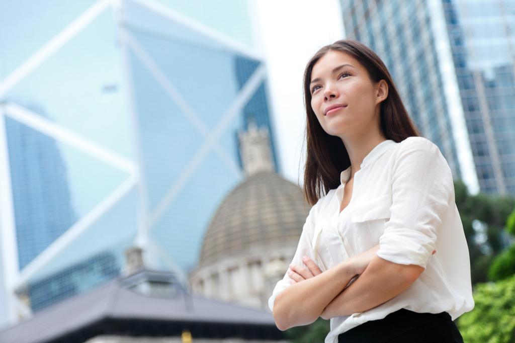 business woman standing tall
