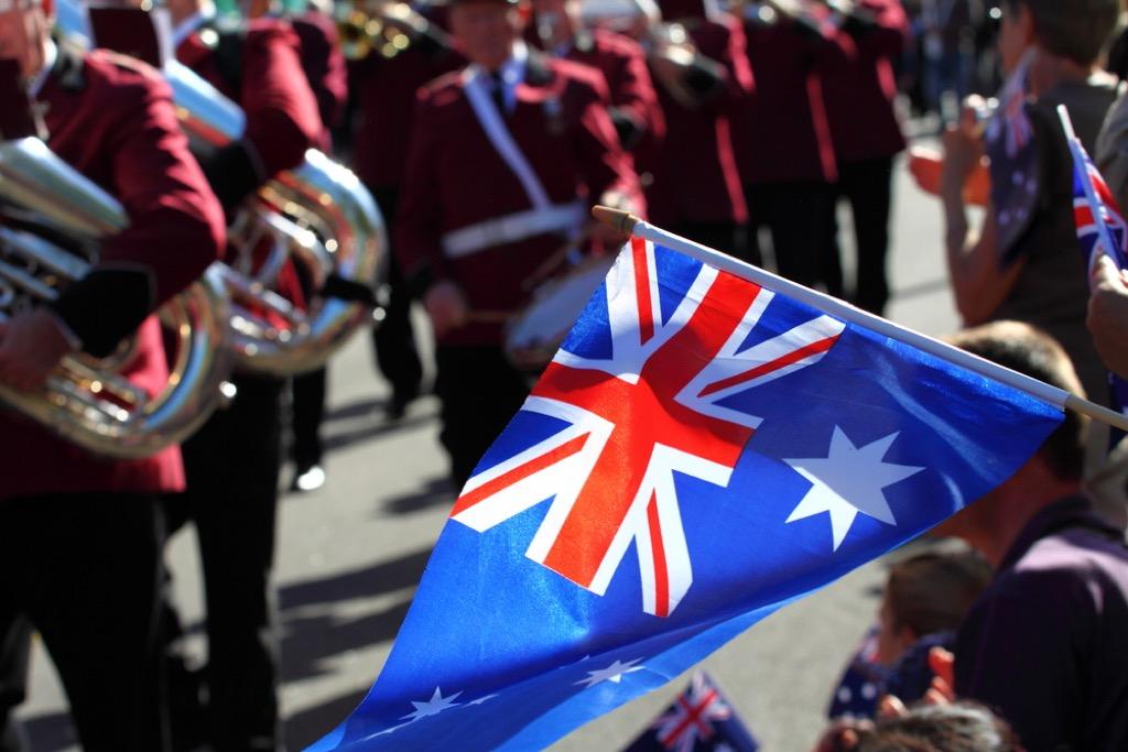 Australian flag being flown at parade