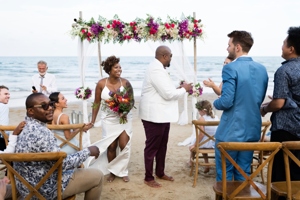 beach wedding bride and groom this is the age most people get married in every US state