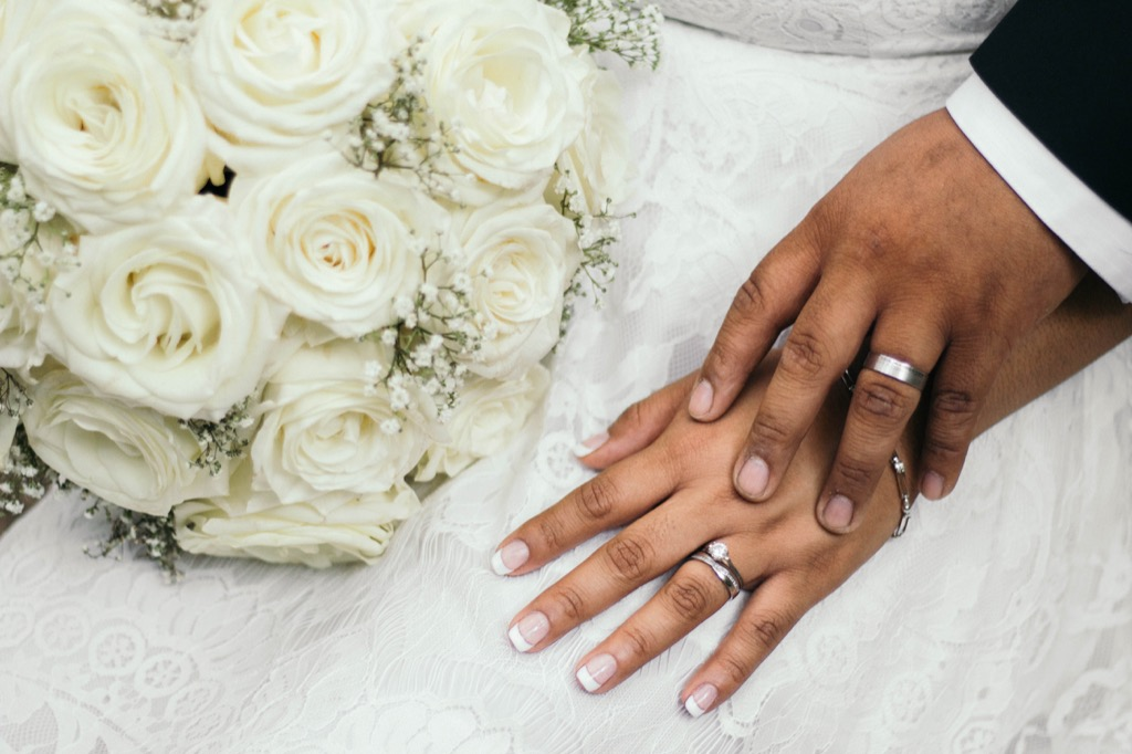 bride and groom hands with wedding rings this is the age most people get married in every US state