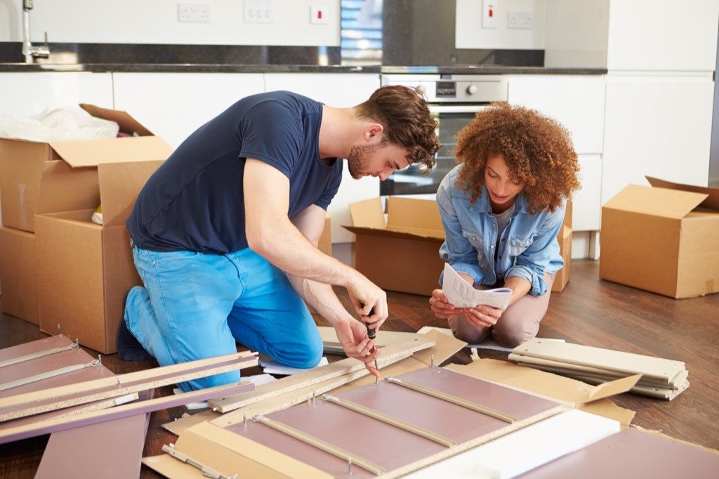 Man and a woman building furniture together.