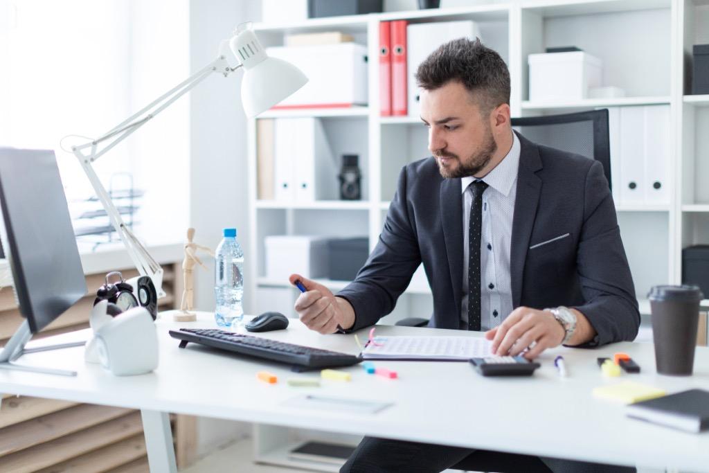 man clicking pen