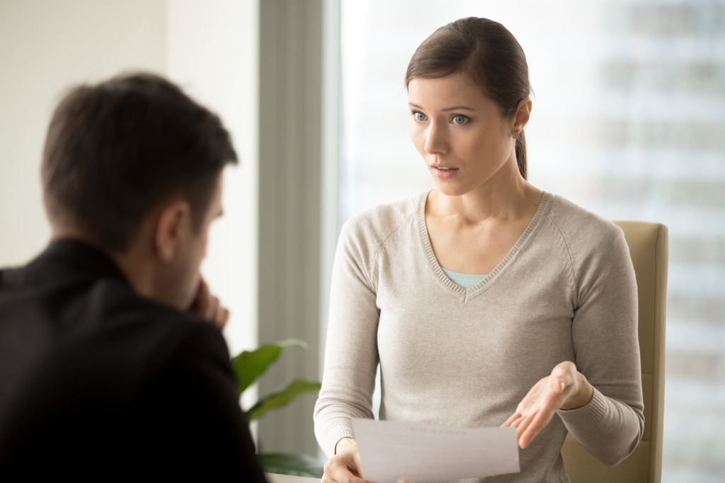 Woman is confronting her boss at work.