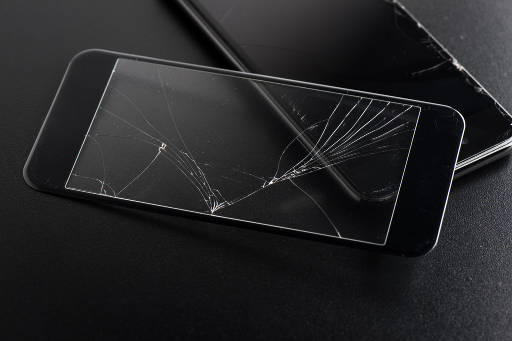Cracked Screen Protector and Smartphone {Get Rid of Old Stuff}