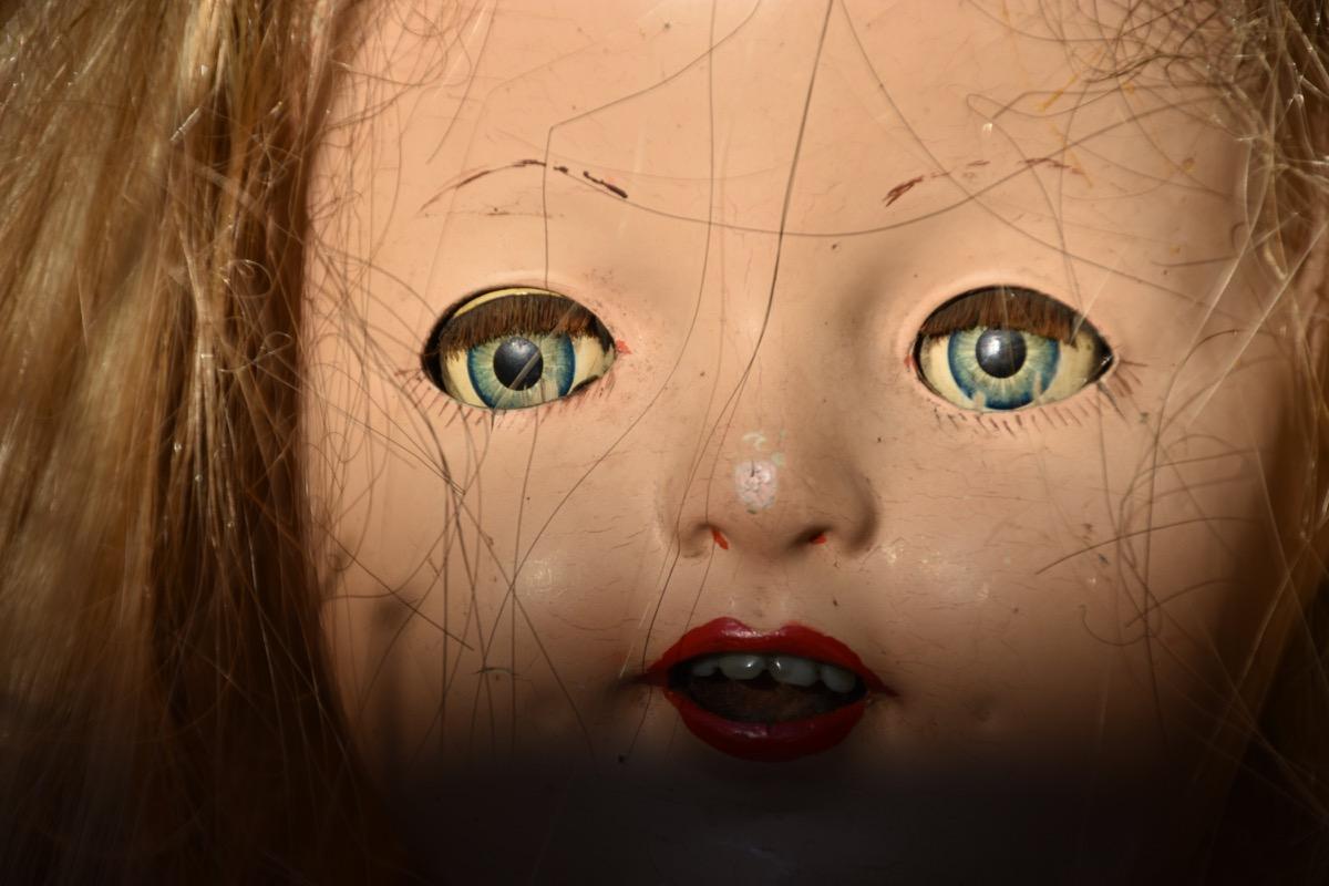 close up shot of a creepy doll face
