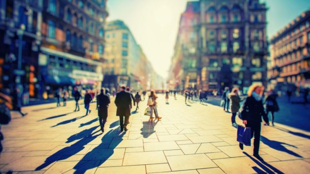 crowd walking in city
