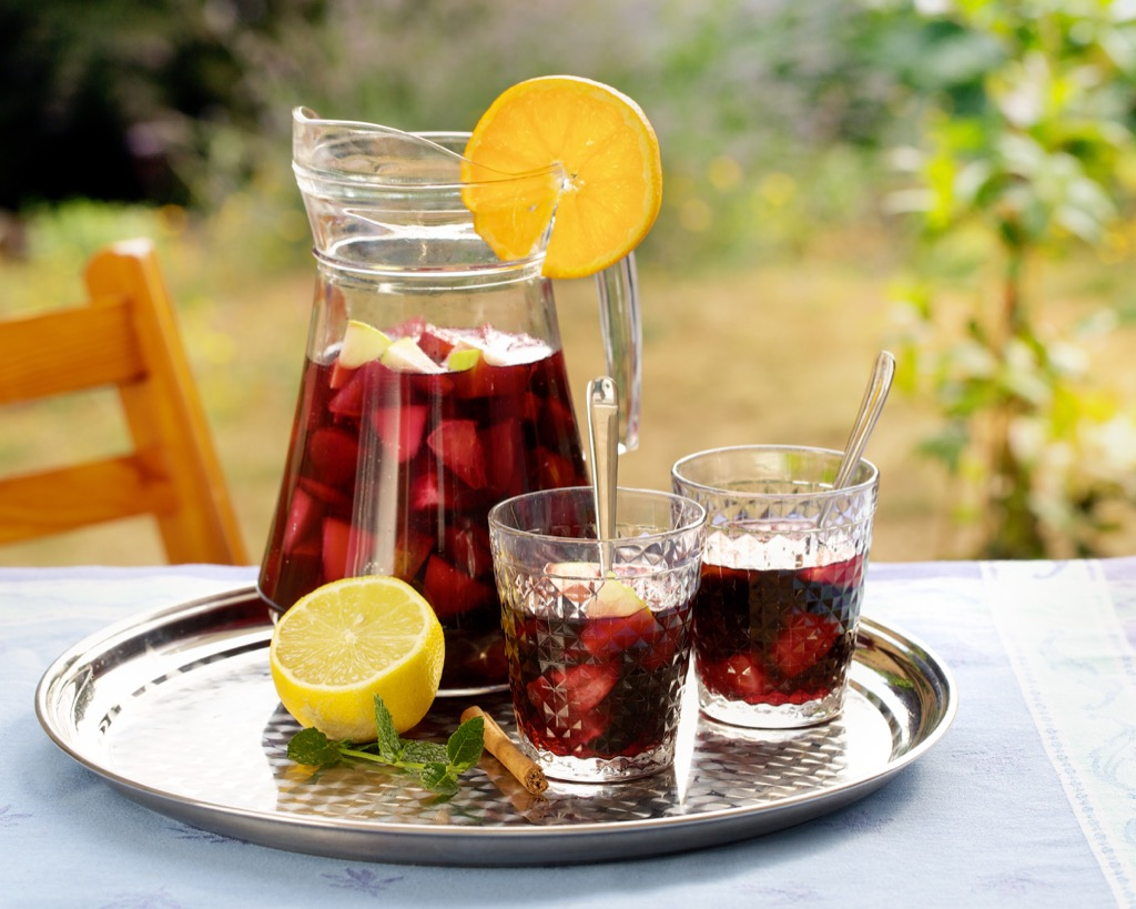 Refreshing summer drink in a pitcher and glasses, sangria