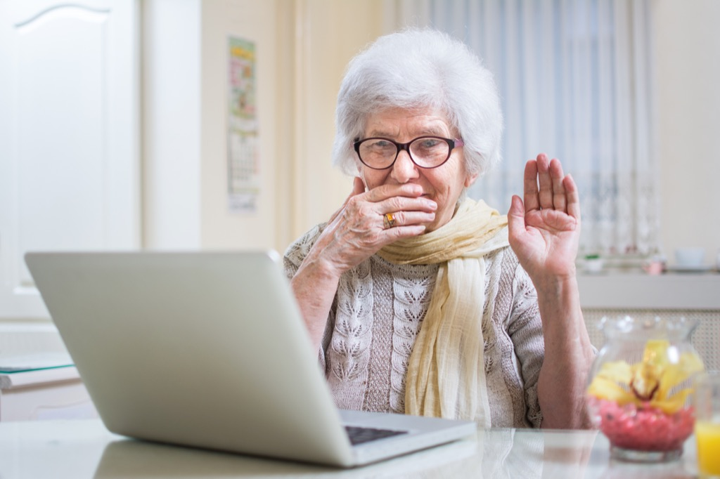 elderly woman laughing at dirty jokes on a laptop, annoying things people do