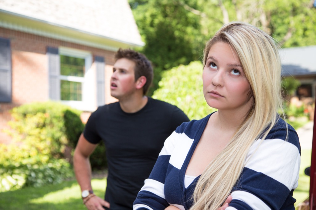 Girlfriend is rolling her eyes during an argument with her boyfriend.