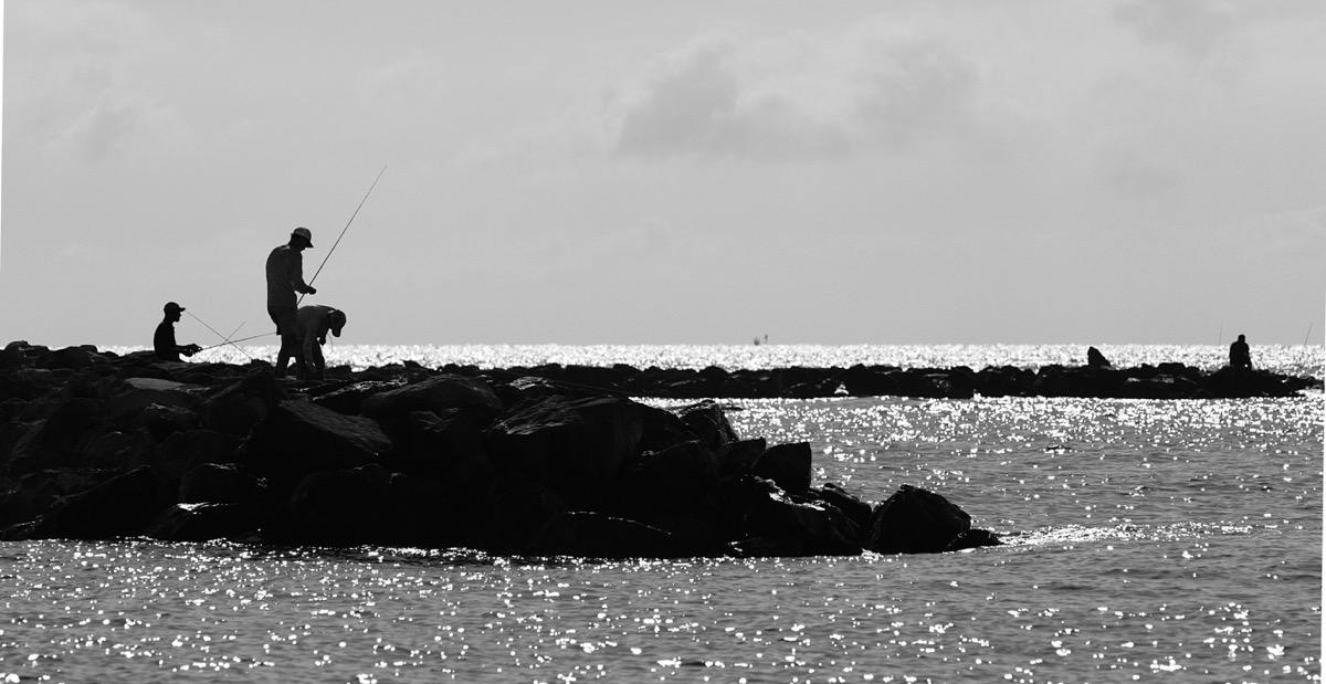 man fishing on dauphin island in alabama