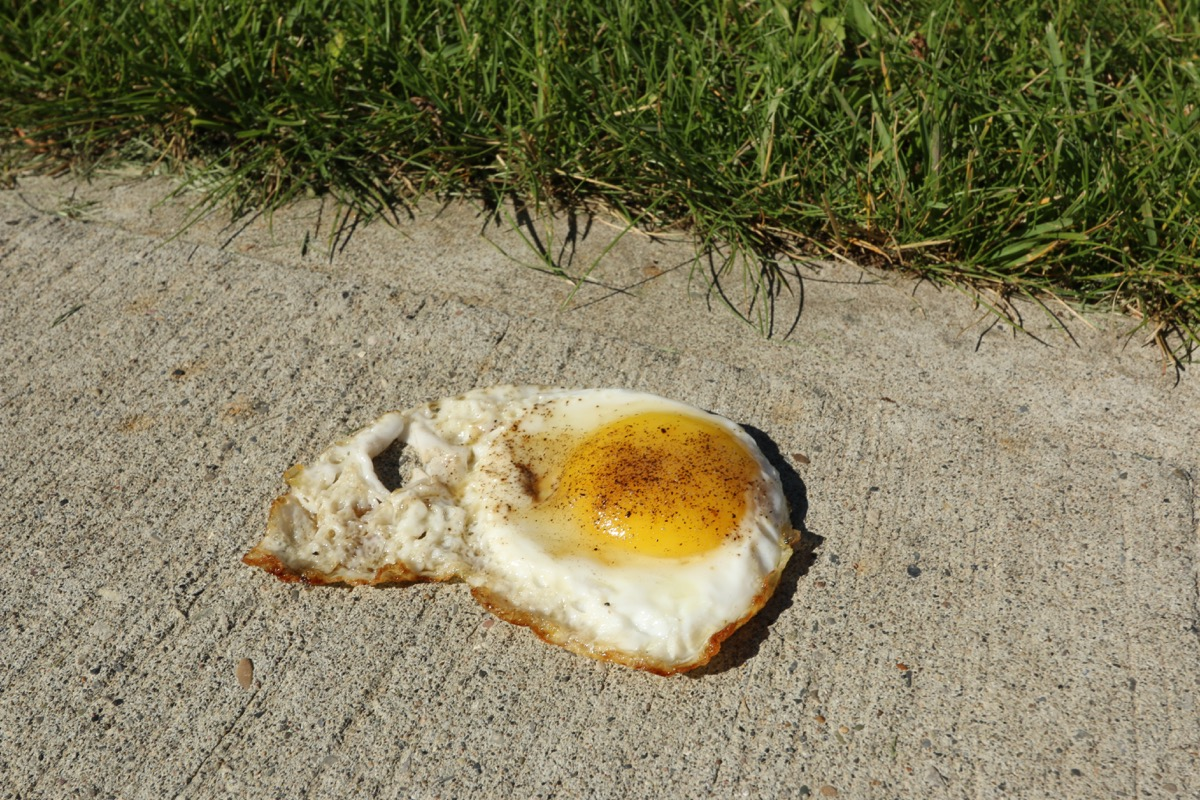 fried egg on a sidewalk