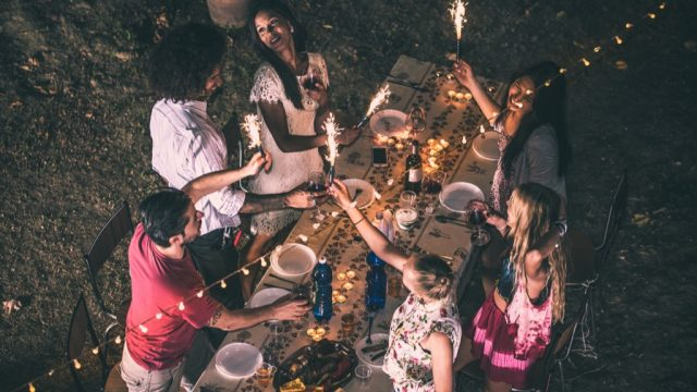 young people partying around a picnic table