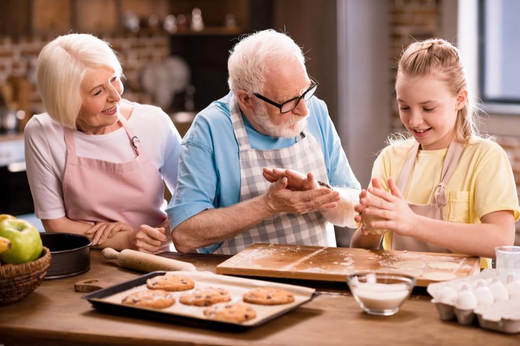 Grandma and grandkids cooking.