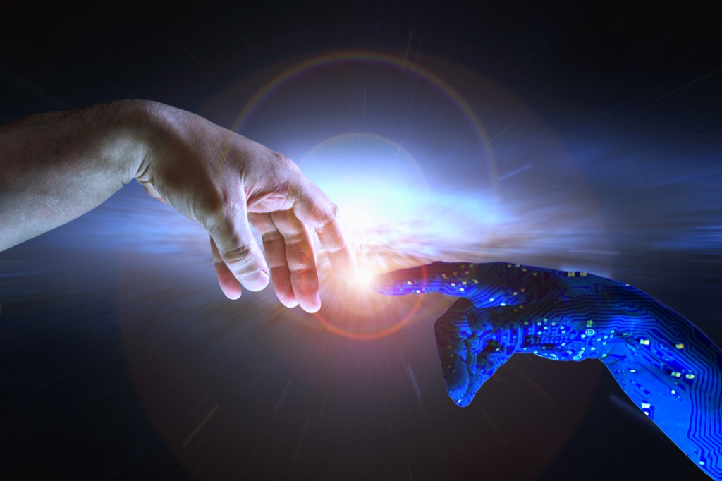 a human hand touching a robot hand