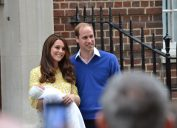 kate middleton and prince william holding a baby