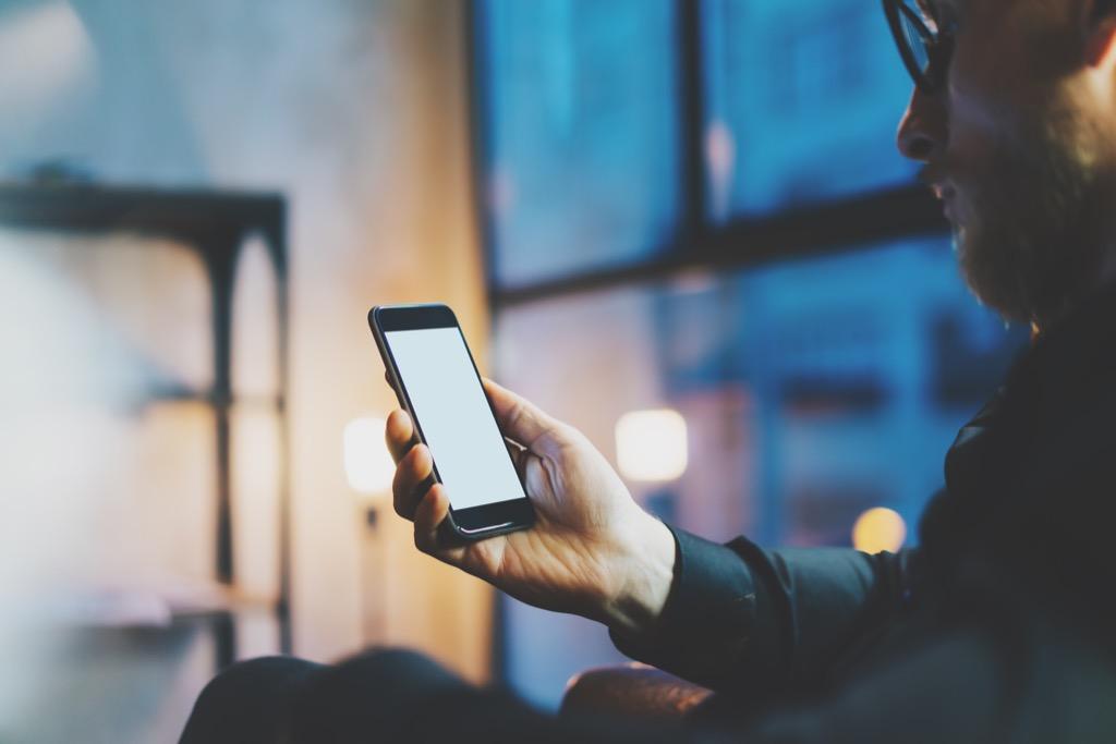 man on smartphone at night