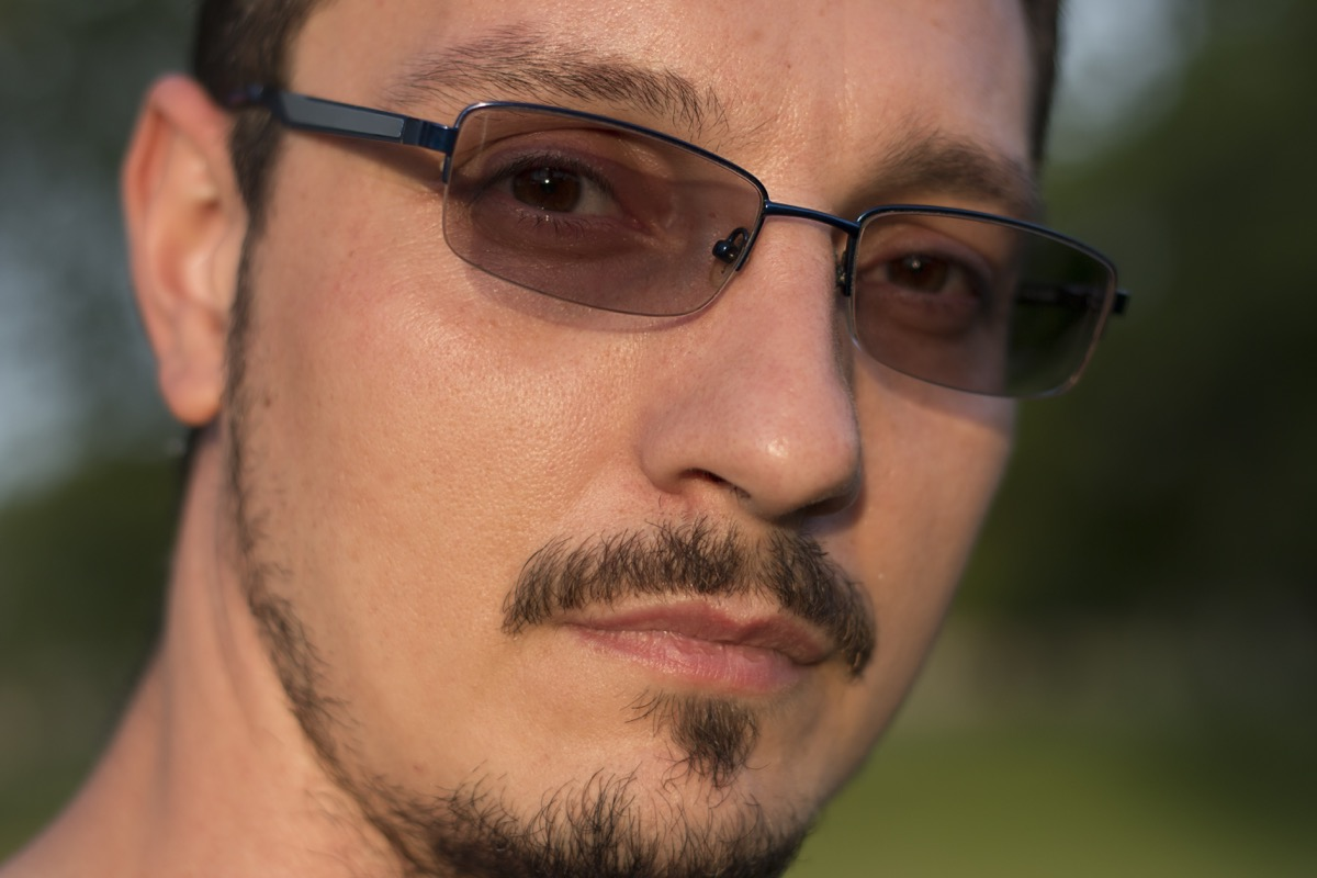 man with a goatee wearing transition lenses