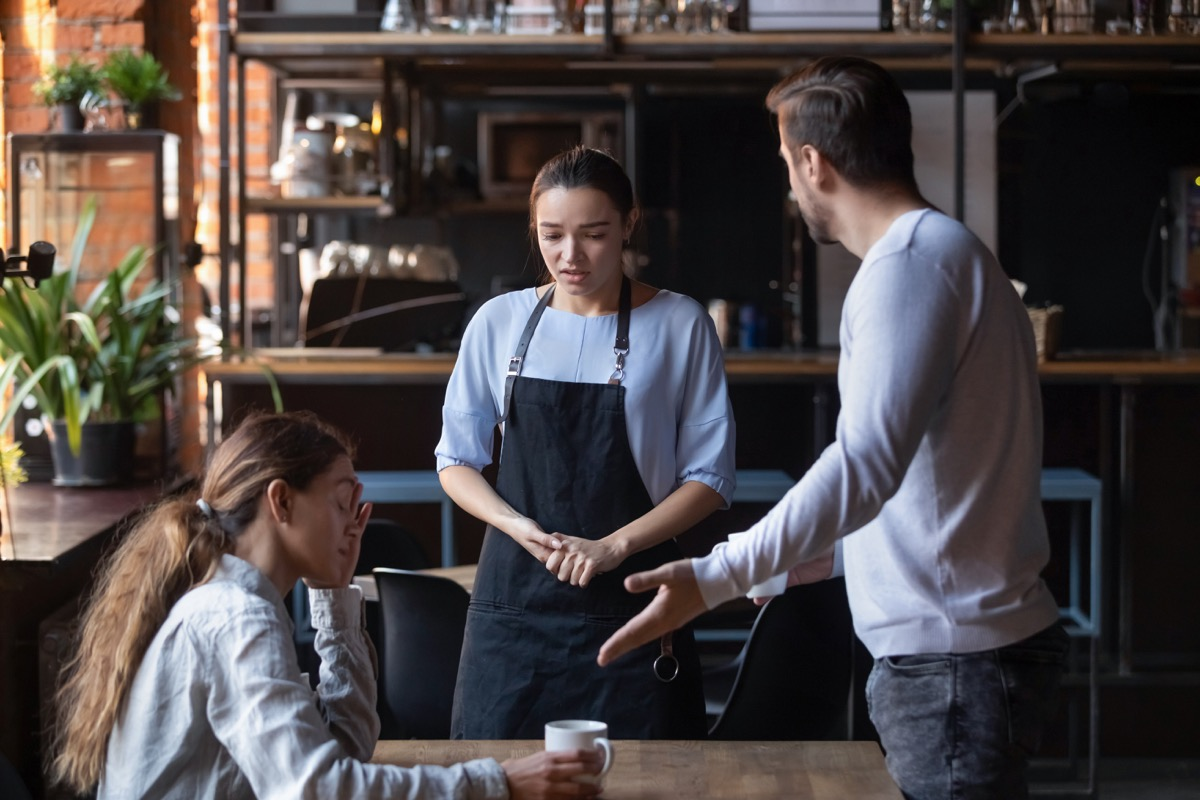 man yelling at waitress on date while upset woman looks on